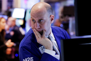 Specialist Meric Greenbaum works on the floor of the New York Stock Exchange.