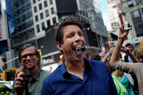 GoPro Inc. CEO Nick Woodman poses with a GoPro Hero 3+ camera in his mouth after ringing the opening bell for the release of the company's IPO.