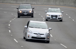 A Toyota Prius (C) drives along highway 101 on November 30, 2010 in Sausalito, California.