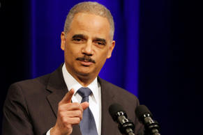 Outgoing Attorney General Eric Holder speaks at an event celebrating his tenure at the Department of Justice in Washington, Friday, Feb. 27, 2015.