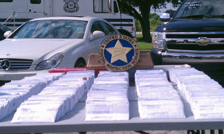 File photo of seized fraudulent tax mailings being displayed during a news conference in Tampa, Florida.