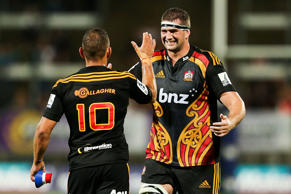 Matt Symons of the Chiefs congratulates Aaron Cruden after kicking a penalty to win the game during the round two Super Rugby match between the Chiefs and the Brumbies.