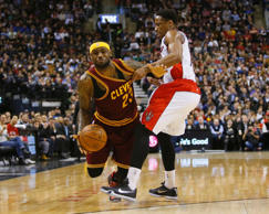 Toronto Raptors guard DeMar DeRozan (10) fouls against Cleveland Cavaliers forward LeBron James (23) at the Air Canada Centre.