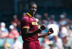 West Indies bowler Jason Holder celebrates after dismissing South Africa's Quinton de Kock for twelve runs during their Cricket World Cup match at the Sydney Cricket Ground (SCG) February 27, 2015.