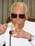Momofuku Ando, the founder of Nissin Food Products Co., eats Chicken Ramen in Osaka, western Japan, in this August 25, 2006 file photo. Ando died on January 5, 2007 at the age of 96.