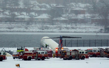 A Delta plane rests on a berm near the water at LaGuardia Airport in New York, Thursday, March, 2015. Delta Flight 1086, carrying 125 passengers and five crew members, veered off the runway at around 11:10 a.m., authorities said. Six people suffered non-life-threatening injuries, said Joe Pentangelo, a spokesman for the Port Authority of New York and New Jersey, which runs the airport. (AP Photo/Craig Ruttle)