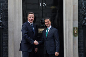 British Prime Minister David Cameron, left, greets the President of Mexico Enrique Pena Nieto outside 10 Downing Street, London, Wednesday, March 4, 2015. Cameron has been accused of running scared over TV election debates with Ed Miliband.