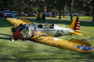 An airplane sits after crash landing at Penmar Golf Course in Venice California March 5, 2015. Celebrity web site TMZ reports the pilot was actor Harrison Ford, who was critically injured in the crash.