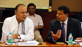File: Arun Jaitley (L) listens to Reserve Bank of India (RBI) Governor Raghuram Rajan during a financial stability development council meeting in Mumbai June 7, 2014.