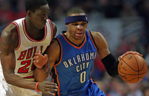 Russell Westbrook #0 of the Oklahoma City Thunder is fouled by Tony Snell #20 of the Chicago Bulls at the United Center on March 5, 2015 in Chicago, Illinois.