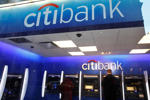 A Citibank customer makes a transaction at an ATM in New York on Jan. 6, 2012.