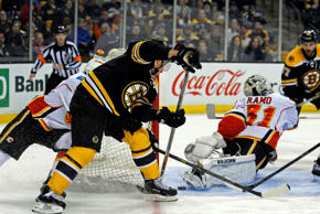 Boston Bruins left wing Brad Marchand (63) scores a goal past Calgary Flames goalie Karri Ramo (31) during the first period at TD Banknorth Garden on Thursday in Boston.