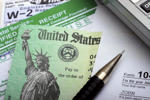 Tax refund check and tax documents.  Jitalia17/Getty Images