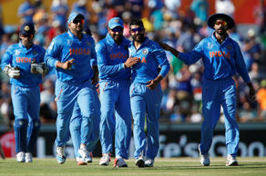 Indian bowler Ravindra Jadeja, second right, is congratulated by teammates after dismissing West Indies batsman Andre Russell during their Cricket World Cup Pool B match in Perth, Australia, Friday, March 6, 2015.