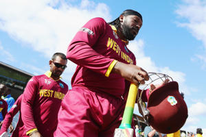 Chris Gayle of West Indies walks out to bat during the 2015 ICC Cricket World Cup match between the West Indies and Ireland at Saxton Field on February 16, 2015 in Nelson, New Zealand.