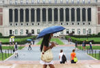 Students walk on the Columbia University campus on July 1, 2013 in New York City.