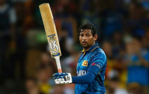 Sri Lanka's Tillakaratne Dilshan raises his bat after reaching his half century during their Cricket World Cup match against Australia in Sydney, March 8, 2015.