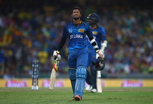 Dinesh Chandimal of Sri Lanka retires hurt with a leg injury during the 2015 ICC Cricket World Cup match between Australia and Sri Lanka at Sydney Cricket Ground on March 8, 2015 in Sydney, Australia.