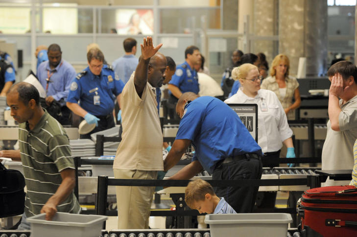 Airline passengers go through the Transportation Security Administration security checkpoint at Hartsfield-Jackson Atlanta International Airport on Wednesday August 3, 2011 in Atlanta. The TSA was created after the terrorist attacks of Sept. 11, 2001. (AP Photo/Erik S. Lesser)