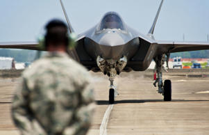 Tech. Sgt. Brian West watches an F-35 Lightning II taxi at Eglin Air Force Base, Fla.