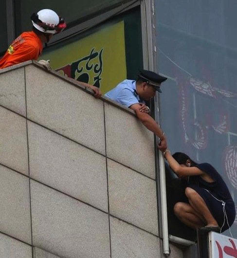 A police officer handcuffs himself to a woman threatening to jump and saves her life.
