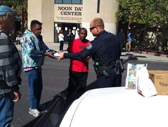 When this police officer learned the Day Center was closed, he bought food for 20 people who had come there to eat.