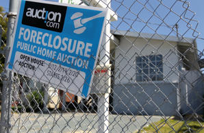 RICHMOND, CA - APRIL 06: A foreclosure sign hangs on a fence in front of a foreclosed home on April 6, 2011 in Richmond, California. The California Housing Finance Agency is expanding its $2 billion foreclosure relief initiative that will now help those who refinanced or took out home equity lines of credit. The agency's largest program offers $875 million in temporary financial help to people who have lost their jobs or had pay reductions and will provide up to $3,000 a month for six months to cover mortgatge payments and related costs. (Photo by Justin Sullivan/Getty Images)