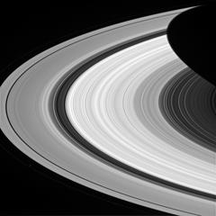 From afar, Saturn's rings look like a solid, homogenous disk of material. But upon closer examination from Cassini, we see that there are varied structures in the rings at almost every scale imaginable. Structures in the rings can be caused by many things, but often times Saturn's many moons are the culprits. The dark gaps near the left edge of the A ring (the broad, outermost ring here) are caused by the moons (Pan and Daphnis) embedded in the gaps, while the wider Cassini division (dark area between the B ring and A ring here) is created by a resonance with the medium-sized moon Mimas (which orbits well outside the rings). Prometheus is seen orbiting just outside the A ring in the lower left quadrant of this image; the F ring can be faintly seen to the left of Prometheus.