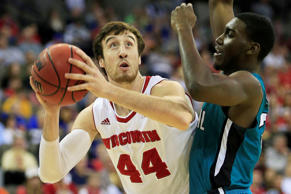 Frank Kaminsky #44 of the Wisconsin Badgers goes up against Tristian Curtis of the Coastal Carolina Chanticleers NCAA Tournament March 20 in Omaha, Neb. Wisconsin won 86-72.