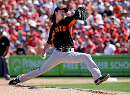 San Francisco Giants starting pitcher Tim Lincecum throws to the Los Angeles Ang...