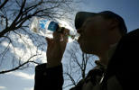 Michael Stefanski of Conservation International drinks Ethos Water while walking along the National Mall area during the second annual Walk for Water on World Water Day March 22, 2006 in Washington,
