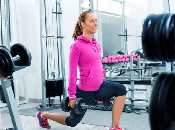 Woman in gym working out her leg muscles