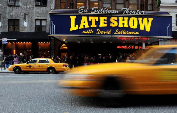 "Slide 1 of 36: Ticket holders wait in line to enter the Ed Sullivan Theatre to watch the first episode of the ""Late Show with David Letterman"" to air since Letterman's production company struck a deal to allow writers to come back to work, Wednesday, Jan. 2, 2008, in New York"