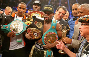 Floyd Mayweather Jr celebrates with the championship belts after defeating Manny Pacquiao (not pictured) after 12 rounds in a unanimous judges decision during a boxing fight at the MGM Grand Garden Arena on May 2 in Las Vegas, Nev.
