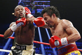 Floyd Mayweather Jr., left, faces off with Manny Pacquiao, from the Philippines, during their welterweight title fight on May 2 in Las Vegas.