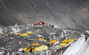 In this Saturday, April 11, 2015 photo, a chopper delivers supplies for trekkers at Everest Base Camp in Nepal.