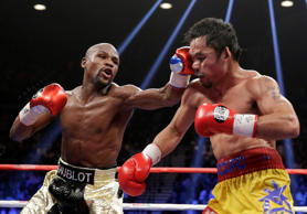 Floyd Mayweather Jr., left, hits Manny Pacquiao, from the Philippines, during their welterweight title fight on May 2 in Las Vegas.