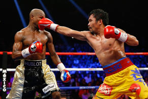 Manny Pacquiao throws a right at Floyd Mayweather Jr. during their welterweight unification championship bout on May 2, 2015 at MGM Grand Garden Arena.