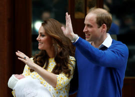 Prince William and Kate, Duchess of Cambridge, hold their newborn daughter as they leave St. Mary's Hospital's exclusive Lindo Wing, London.
