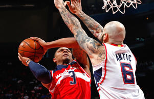 Bradley Beal (left) of the Washington Wizards shoots against Pero Antic of the Atlanta Hawks during game one of their NBA playoffs matchup on May 3, 2015, in Atlanta.