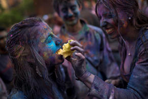 A reveler shares an apple with her friend during a Holi Festival in Madrid, Spain. Andres Kudacki/AP