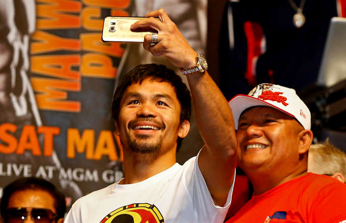 Manny Pacquiao takes a selfie during his official weigh-in on May 1 at MGM Grand Garden Arena in Las Vegas.