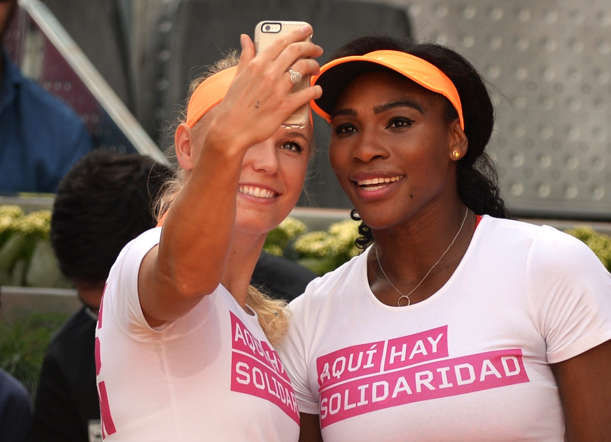 Tennis players Serena Williams, right, and Caroline Wozniacki take a selfie during a charity event held on the ocassion of the Mutua Madrid Open tennis tournament in Madrid, Spain, on May 1.