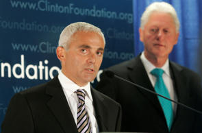 Frank Giustra, a Canadian businessman, speaks as former President Bill Clinton looks on during a news conference to announce the Clinton Foundation's launching of a new sustainable development initiative in Latin America Thursday, June 21, 2007 in New York.