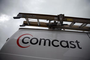 A Comcast service van is shown on April 23, 2015 in Miami, Florida.