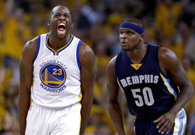 Golden State Warriors forward Draymond Green (left) celebrates after making a three point basket in front of Memphis Grizzlies forward Zach Randolph during game one of their NBA playoff matchup on May 3, 2015, in Oakland, Calif. The Warriors won 101-86.