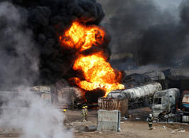 File: Smoke and flames rise from fuel trucks after an overnight attack by the Taliban on the outskirts of Kabul July 5, 2014.