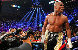 Floyd Mayweather, Jr. yells out to the crowd after defeating Manny Pacquiao in their welterweight WBO, WBC and WBA (Super) title fight in Las Vegas, Nevada, May 2, 2015.
