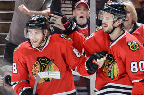 Patrick Kane, left, and Antoine Vermette of the Chicago Blackhawks celebrate after Kane scored an empty-net goal in the third period against the Minnesota Wild in game two of their playoff series May 3 in Chicago. Kane also scored in the second period in the Blackhawks' 4-1 victory.