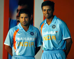 India's Sachin Tendulkar (L) and Captain Rahul Dravid showcase new uniform for the upcoming Cricket world cup, during its launch in Mumbai February 20, 2007.